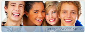Four young teenagers wearing Invisalign Braces